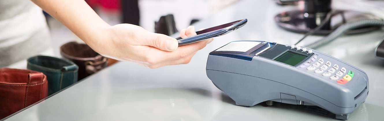 Shopper using a Cell Phone to pay at a payment terminal